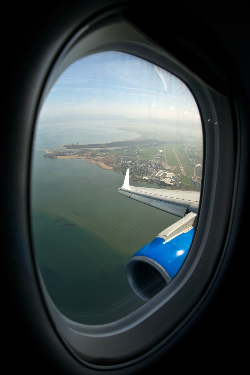 Look out of the airplane window on Lake Constance and St. Gallen-Altenrhein Airport