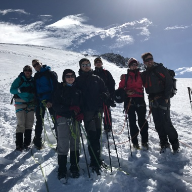 Our group of 7 was split into two rope teams. A few meters under the summit we united for a group photo.