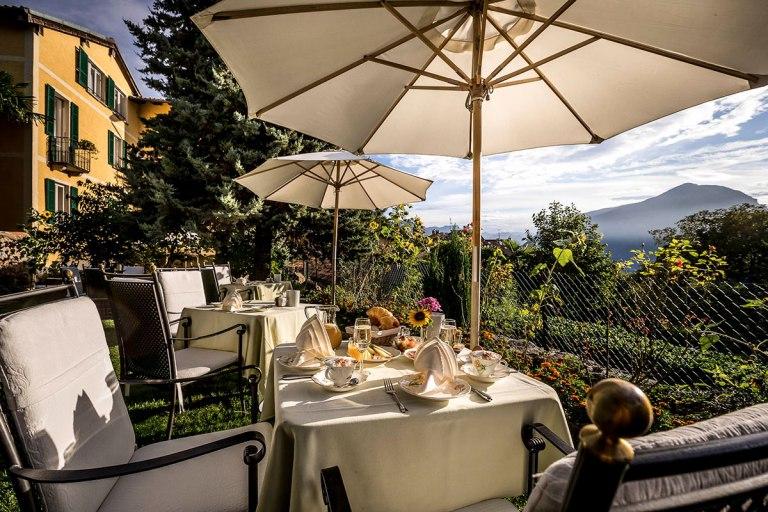 Breakfast in the garden of Hotel Villa Carona