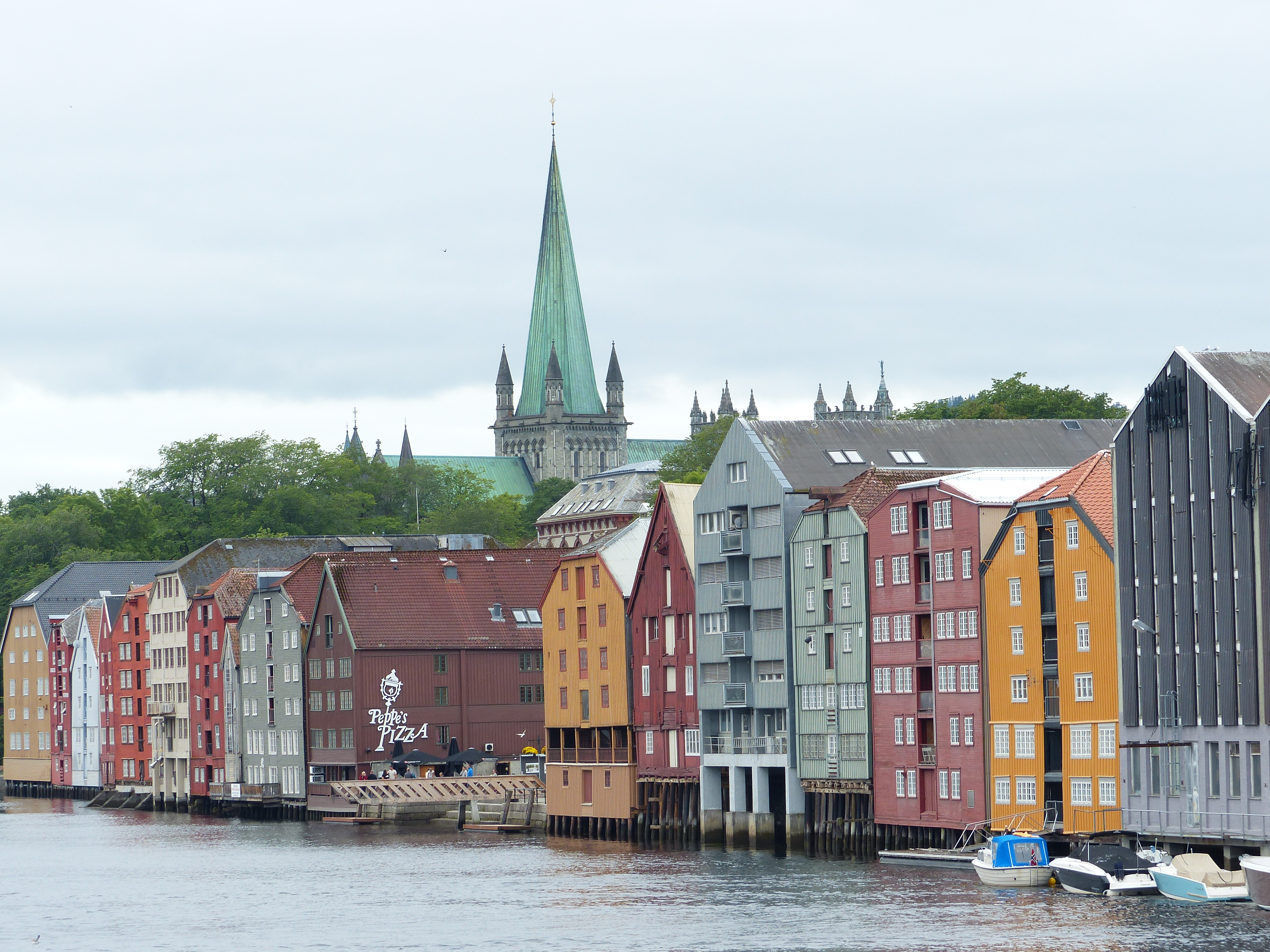Colourful wooden warehouses in front of Nidaros Cathedral in Trondheim
